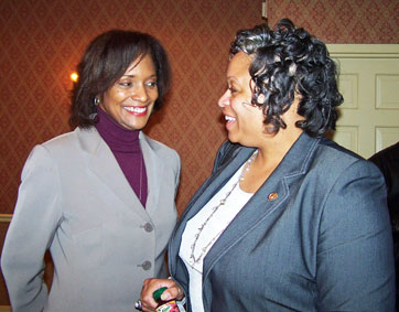 Newly state Rep. Camille Lilly (left) talks with her predecessor, Ald. Deborah Graham in April after local political officials chose her to complete Graham's term. (Photo/Austin Weekly News)