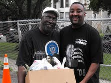 Pastor Steve Epting (left) helps hand out food earlier this summer.