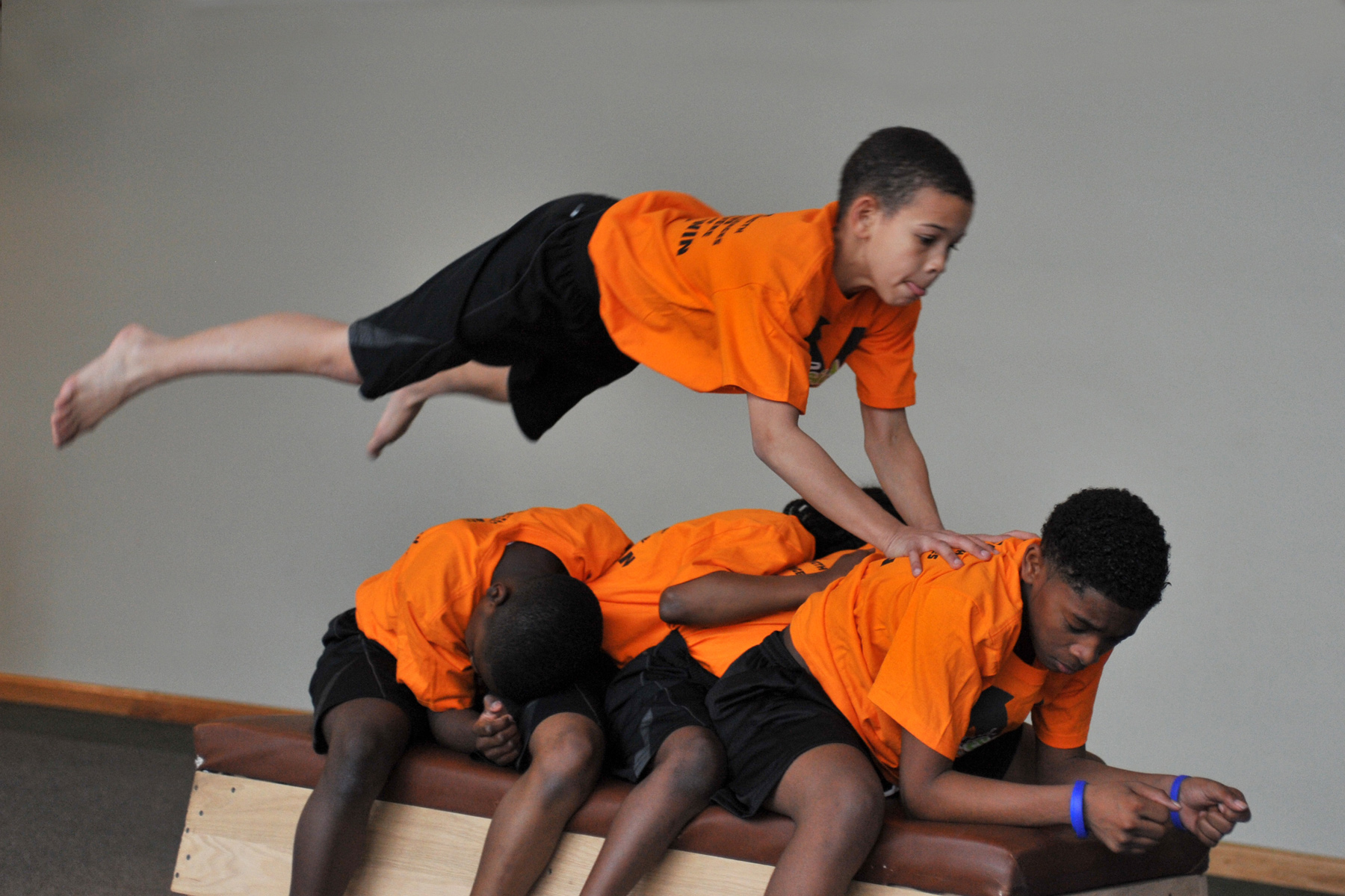 Leaping over each other, juggling and balancing on a unicycle are all part of these acrobats' routine. As they propel into the air from the trampoline, these students have come to understand direction and persistence through the arts.