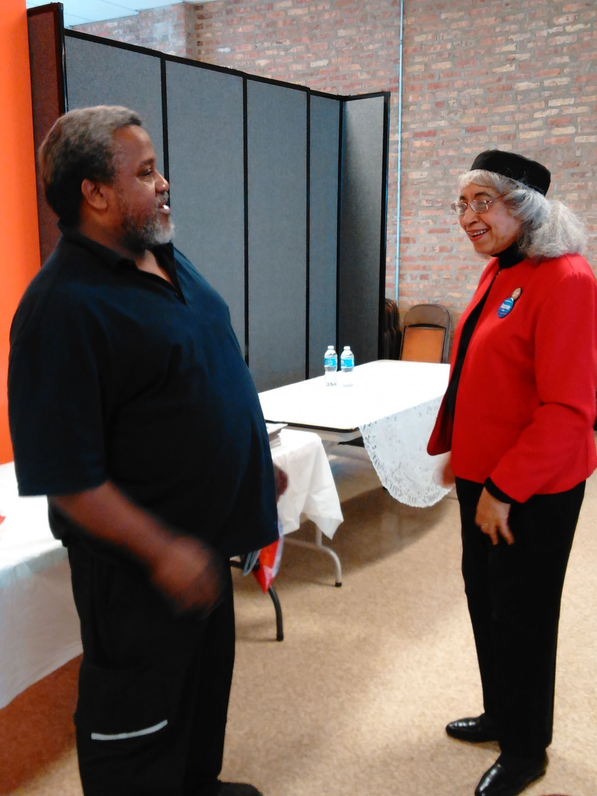 Brenetta Howell Barrett talks with George Owens at a voter's rights town hall Saturday in Austin.